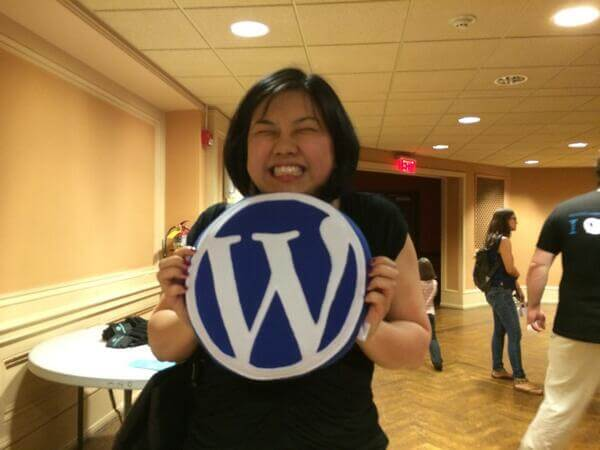 Helen receiving her WordPress pillow from the folks at YIKES.
